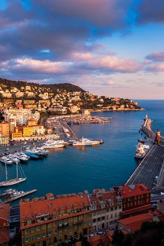 Sunset lights the slope of the far end of the Nice harbour. Nice is the fifth largest French city and is a popular holiday desination on the French Riveria.   Jon & Tina Reid   |    Portfolio    |  Blog