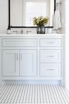 "Black and white tile with Benjamin Moore ""Woodlawn Blue"" Cabinets 