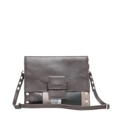 Seamlessly transition from work into a night out with this versatile messenger bag. The Joe features a spacious, suede-lined compartment with a cover flap, a l