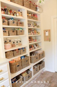 Wicker baskets create a unified and clean space - and are sturdy enough to keep bottles and packages standing upright. See more at Eleven Gables.