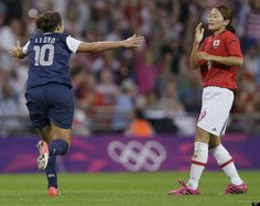 United States' Carli Lloyd celebrates her second goal in front of Japan's Nahomi Kawasumi during the women's soccer gold medal match at the 2012 Summer Olympics, Thursday, Aug. 9, 2012, in London.