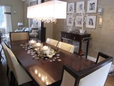 Dinning room with awesome chandelier. It looks like it is dripping diamonds ~ love it!