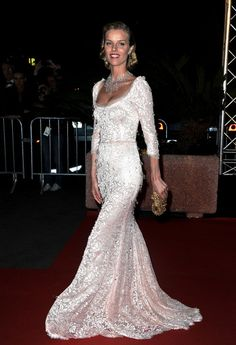 Eva Herzigova  Leave it to a supermodel to upstage all the film talent at Cannes. Eva Herzigova was goddess-like in a slim-fitting Dolce & Gabbana gown dripping with crystal beads. Her very serious diamond necklace likely came with its own security guard.