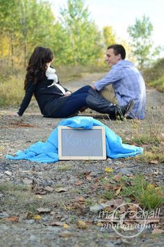 Maternity photography. Could be a cute way to announce the baby name & gender.
