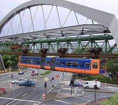 The Wuppertal Suspension Railways is one a kind elevated railway located in Wuppertak, Germany. It is the oldest elevated railway in the world, though it doesn't look like it. Locomotive, Wuppertal Germany, Attractions In Germany, Tramway, S Bahn, Light Rail, Model Train Layouts, Train Travel, Public Transport