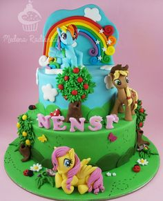Two tiered My Little Pony Birthday cake with Rainbow Dash, Apple Jack and Fluttershy.