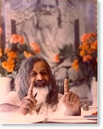 His Holiness Maharishi Mahesh Yogi in front of photo of his master, Shri Guru Dev, His Divinity Swami Brahmananda Saraswati
