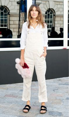 Alexa Chung accessorizes her overalls and Birkenstocks with a furry clutch. // #StreetStyle #Celebrity