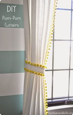 Neon yellow trim with dangling pom-poms adds texture and serious fun factor to all-white curtains. We love that even the curtain tie features the same matching details. Get the tutorial at Beckham + Belle »