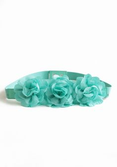 "Charmed Ways Floral Belt In Mint 16.99 at shopruche.com. This elasticized mint belt with a trio of raw edged rosettes is perfect for adding a hint of romantic charm to your style.28.5"" long"