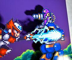 Este shadowbox de 9 x 9 es inspirado en el clásico videojuego Mega Man X y hecho con materiales impresos de alta calidad para un aspecto nítido y colores que parecen está mirando en la pantalla otra vez. Personajes y paisajes sutilmente elevado sobre el fondo, así como contra el cristal