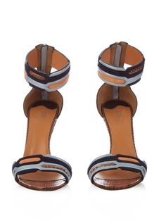 Bold colourways are second nature to Peter Pilotto, and these stiletto-heel sandals are an easy way to work the look. Part of the label's first footwear collection, they feature geometric straps in shades of orange, black and silver, with accents of tonal-brown snakeskin. Let them peak from beneath an ankle-skimming dress.