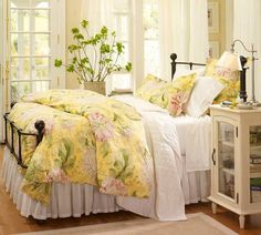 Interesting night stand. Yellow bedspread with pink flowers.  Pretty