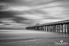 Amelia Island Fishing Pier, Fernandina Beach, Florida Created with a 10-stop filter to smooth out the big waves and puffy clouds from Tropical Storm Cristobal.