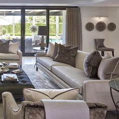 Bronze and taupe colour scheme in the formal lounge at the villa project #livingroom #lounge #taupe #bronze #luxuryinteriors #luxuryhomes #homedecor #SophiePatersonInteriors