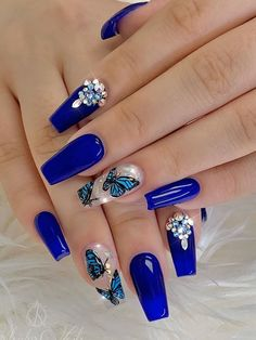 Cute royal blue coffin nails set with rhinestones and butterflies on accent nail! Blue Gel Nails, Coffin Nails Ombre, Bling Acrylic Nails, Almond Acrylic Nails, Best Acrylic Nails, Rhinestone Nails, Royal Blue Nails Designs, Blue Nails With Design, Fancy Nails Designs