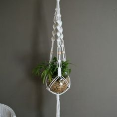 white macrame plant hanger. Beautiful pot!