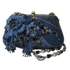 Ladies Who Lunch by Mary Frances  Looking for that perfect bag to bring out with you for a date with the girls? The Ladies Who Lunch is just that. Constructed out of denim, this cute bag is uber fun and flirty! The floral design and exquisite bead work are just as fabulous as you are and will have all the ladies a buzz!