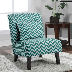 Versatile fashion highlights the design of this Anna Peacock accent chair featuring a chic peacock and white chevron print fabric. This lovely chair showcases solid hardwood legs and includes a matching pillow.