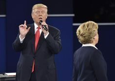 <p>Republican presidential candidate Donald Trump spekas as Democratic presidential candidate Hillary Clinton listens during the second presidential debate at Washington University in St. Louis, Missouri on October 9, 2016. (Paul J. Richards/AFP/Getty Images)</p>