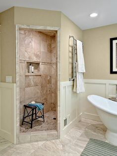A Walk-in Shower Instead of a Bathtub: Pros and Cons : Coastal Style Bathroom With Free Standing Bathtub And Heated Towel Bar Plus Limestone Tile And Walk In Shower
