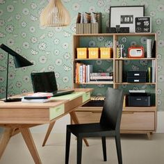 Retro home office | A mix of different prints create a retro scheme in this office. Touches of black break up large expanses of wood. | Chosen by Ideal Home | Photograph by Dominic Blackmore