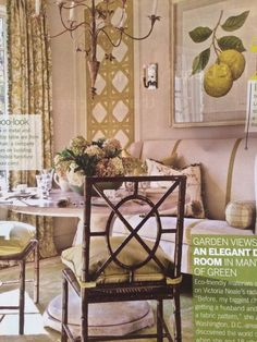 Green dining room, linen setee, dining bench, round dining table, artisan metal chandelier from Iatesta & Company, lattice pattern wall art with linen tape by Designer Victoria Neale   Traditional Home, April 2010