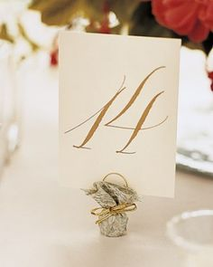 Formal Table Card Gold calligraphy makes an elegant statement at this city wedding.