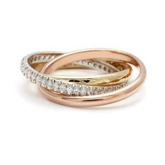The InterlockingBands symbolize love eternal with three eternitybands intertwined in perfect harmony, in a trilogy of golds. This set combines one gold textureband, one gold smooth half round bandpaired with another gloriously set French pavé diamond band.