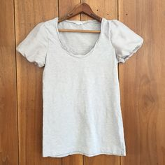 J. Crew Tissue tee with silky sleeves J. Crew Tissue tee with silky like puff sleeves. Light grey in color. Label reads small but it's between small and medium. Definitely not a fitted shirt. Worn only a few times. No spots, marks or signs of wear. J.Crew Tops Tees - Short Sleeve