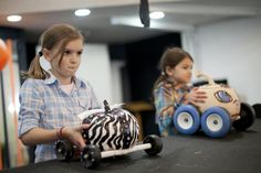 Torie Brockbank, 10, prepares to race her pumpkin, called ZB, at the Screaming Pumpkin Derby.