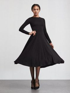 The Tammy Black Dress - engineered for twirling. This is a super soft, stretch jersey midi dress with a scoop neckline and long sleeves. It's fitted through the bodice and waist then the skirt goes full. So comfortable you'll forget how cute you look.  https://www.thereformation.com/products/tammy-dress-black?utm_source=pinterest&utm_medium=organic&utm_campaign=PinterestOwnedPins