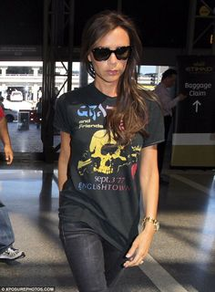 Jetsetter... Victoria Beckham was pictured arriving at LAX on Wednesday as she hid her eyes behind large sunglasses