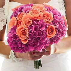 Orange Rose Bouquet | Orange roses and pink hydrangeas add a dramatic pop of color to this bouquet. | SouthernLiving.com