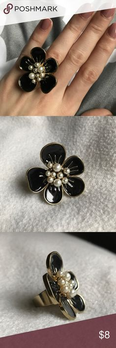 Black flower ring Cute black and gold flower ring with faux pearl detailing. Forever 21. Fits size 6. Never worn, excellent condition. Other items pictured also available from my closet!                            🌸Make me an offer!🌸 Everything must go! Create and buy bundle with at least 2 items and automatically save 10%. I offer private discounts on nearly all bundles. Forever 21 Jewelry Rings