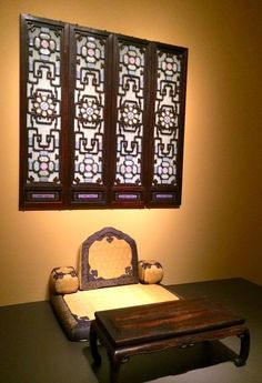 Imperial yellow cushion for the Qing Dynasty emperor's writing desk on display in the Forbidden City palace Museum.