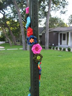 Yarn bomb flowers on stop sign