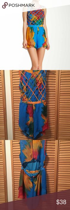 Tropical Lattice Romper Multicolor lattice, bodice romper with zipper and buttons in the back. The shorts part of the romper is fluttered. There is also a back cut out. WOW couture Other