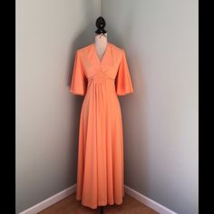 """Vintage maxi dress Sz measures (see desc) Amazing vintage maxi dress. This is a beautiful peach maxi dress with attached tie (looks like basket weave detail on the front design.)  Has butterfly kimono type sleeves. Back zip with two buttons at top of neck.  See last pic there are some light stains but with the way the pleats fall you can't really notice. There is no size, my mannequin is a Sz 6 and it fits her really well. measurements: length 54"""". bust approx. 36-38"""". Waist approx 32"""". Hips…"""
