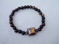 Orange and Ebony Tropical Wood Bead Bracelet 7 Inch by Spasojevich, $19.00