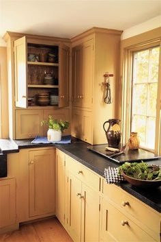 Kitchen - soapstone counter, cabinets, windows