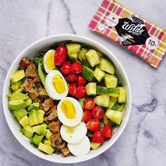 Paleo cobb salad for a late lunch! (Avocado, cucumber, tomato, @vitalfarms hard boiled egg, & @wildesnacks oven baked turkey cranberry bar crumbled up into pieces - I used this as a healthy alternative to bacon - it's made with 100% free range turkey that is hormone + antibiotic free, has 10g of protein and is only 100 calories! #paleo #glutenfree