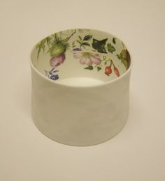 Delight tea-light holder by Karin Eriksson - cast bone china, a material that lets the light shine through beautifully when the candle holder is lit. decorated with screen-printed ceramics decals.
