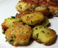 """Parmesan Garlic Roasted Potatoes  Ingredients: Potatoes Cut in to smaller size pieces (I use Russet Potatoes) - A few tablespoons of olive oil - 2-3 cloves garlic, minced - 1 to 2 Tablespoons fresh chopped parsley - Fresh grated Parmesan cheese -  Salt and pepper, to taste."""