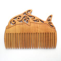 Hand carved wooden combs and hair pins in walnut, ash, yew, elm and box. Buy online.