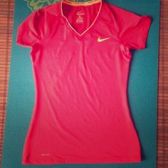 """Selling this """"Jed vneck Nike Pro DriFit top in pink and orange"""" in my Poshmark closet! My username is: tinovia. #shopmycloset #poshmark #fashion #shopping #style #forsale #Nike #Tops"""