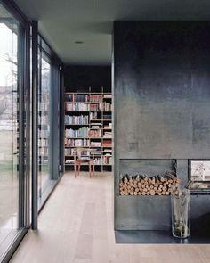 concrete wall + large window + wood floor + bookshelf beyond   House P by Bechter Zaffignani Architekten   ~via ideasgn.tumblr.com
