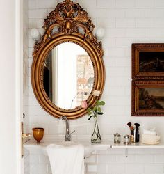 An ornate, gilded mirror and small art elevate the look of this powder room, while a white shelf adjacent to the floating sink provides a surface for grooming essentials. Bad Inspiration, Bathroom Inspiration, Home Decor Inspiration, Decor Ideas, Mirror Inspiration, Mirror Ideas, Vanity Ideas, Diy Ideas, Decorating Ideas