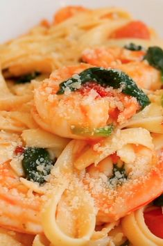 Shrimp Tomato Spinach Pasta in Garlic Butter Sauce - a delicious Italian pasta dish with lots of fresh ingredients! I absolutely love combining shrimp, pasta, and tomatoes. My long-time favorite is spicy shrimp pasta with Garlic Butter Shrimp Pasta, Garlic Butter Sauce, Shrimp Pasta Tomato, Butter Dish, Cooking Dishes, Cooking Recipes, Healthy Recipes, Seafood Recipes, Pasta Recipes
