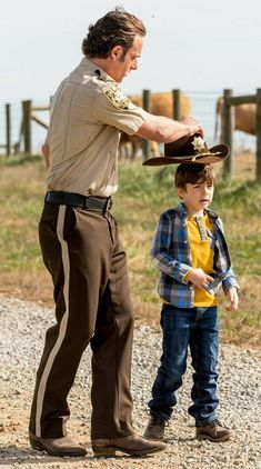 RICK GIVES A YOUNG CARL HIS SHERIFF'S HAT!